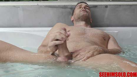 Venezuela superstar Ramon Nomar strokes his thick uncut prick and lets the jets tickle his backside as he christens the See HIM Hot Tub.