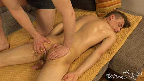 Aron Berger is due for a massage. He strips down to his underwear, showing off his sexy, slim, body, and lays face down on the sofa. The masseur arrives and kneels beside Aron as he begins to work.