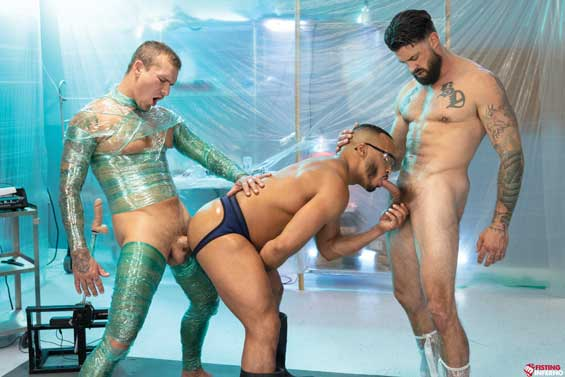 Dillon Diaz is on his knees gettingpenetratedby a fuck machine as he sucks Isaac X's thick cock. Alpha Wolfe is behind Dillon toying with his hole as the silicone cock slides in and out of Dillon's ass.