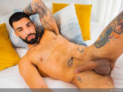 """Inked, pierced, and hairy Spanish bro Yah Jil is Hot AF. Watch as he showers, soaps up his muscular body, and plays with his 8"""" uncut, thick cock."""