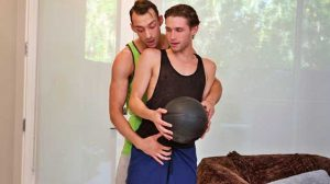 After a demanding basketball game, Johnny B helps his younger stepbrother, Shae Reynolds, work on his form. But Johnny soon learns that Shae has feelings for him.